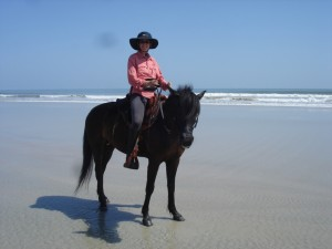 Sabine Dickel riding Bucksnorts Sweet Violet on the beach,